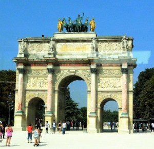The Arc de Triomphe sits at the end of the the Avenue des Champs Elysees, unchanged over time. The same as it was when Hitler marched through it celebrating German victory over France.