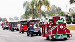 This Christmas Golf Cart Parade isn't the one that passed by our house. Our parade came at night and I was too excited to take a picture. This example is not the fun parade we had.