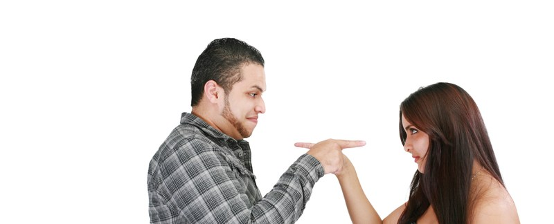 A young couple blaming each other in a relationship. This post offers relationship advice to solve relationship problems.