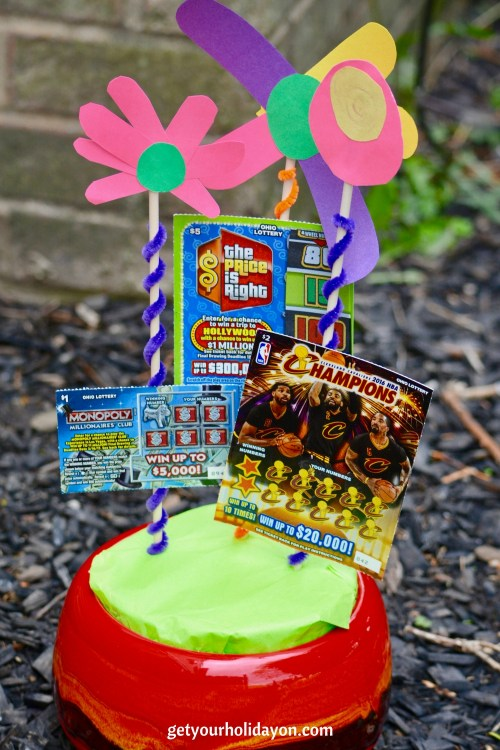 Bringing flowers to your mom, grandma, aunts, sister, or a friends? Why not try a different approach and give the gift of a DIY flower lottery ticket gift basket. These one-of-a-kind flowers are sure to grab their attention and make a sweet interesting present.