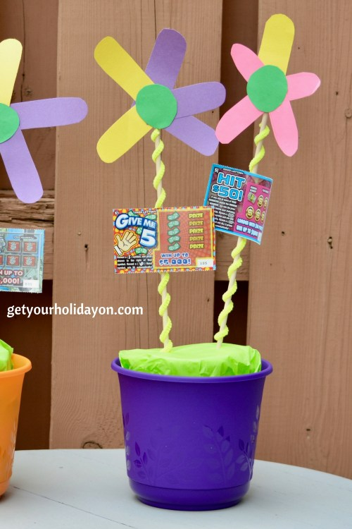 If you're looking for a simpler gift idea you could do something like this flower pot. We added two lottery tickets and two flowers. This created an easy and fun gift idea.