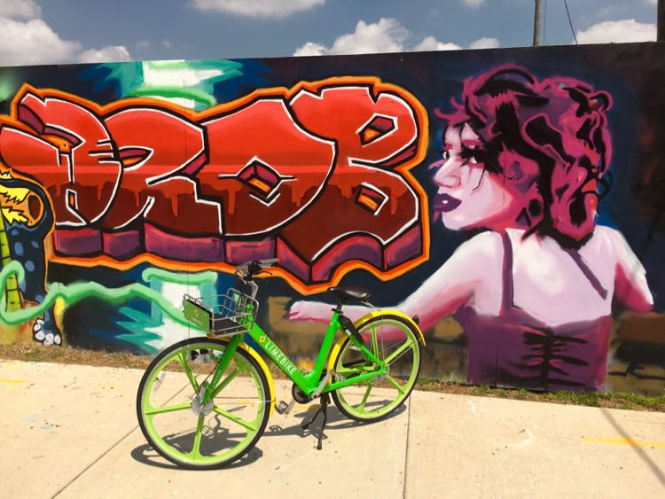 street art mural and Lime bike in South Bend Indiana