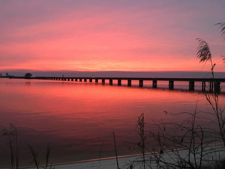 catch a Coastal Mississippi sunset next to Biloxi Bay Bridge