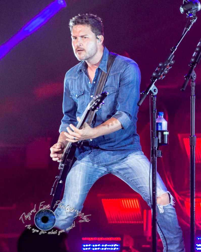 Ryan Peake of Nickelback performing at Hollywood Casino Amphitheatre in Saint Louis. Photo by Sean Derrick/Thyrd Eye Photography.