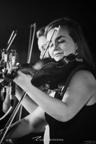 Sophia (left) and Hulda Quebe playing their fiddles. Photo courtesy of Ryan Ledesma.