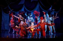 """""""The Coney Island Waltz"""" featuring Richard Koons (""""Squelch""""), Katrina Kemp (""""Fleck""""), Stephen Petrovich (""""Gangle"""") and the Ensemble of Love Never Dies. Photo: Joan Marcus."""
