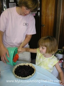 Putting berries in the pie shell