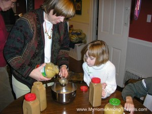 Making cinnamon applesauce ornaments