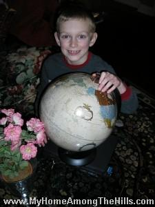 Isaac with his globe 2007