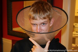 The boy wearing an Elizabethan collar