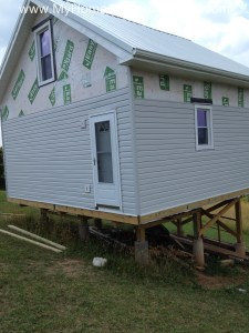 Installing siding on the house