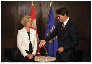 rachel-notley-justin trudeau-awkward-handshake-tmx-pipeline