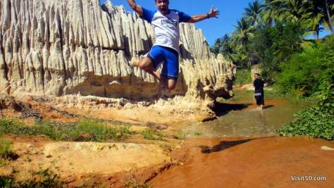 Jumping over the red sand dunes of Mui Ne, Vietnam