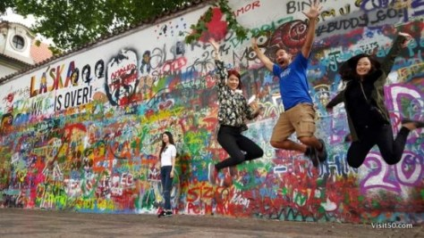 Jumping with new friends at the Lennon Wall in Prague