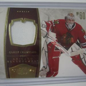2010-11 Panini Dominion #23 COREY CRAWFORD Game Used Jersey Patch Card #d 27/99