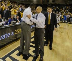 Former Rams head coach Shaka Smart shakes hands with former Rams head coach Anthony Grant after VCU routed Alabama, 74-54 on Dec 15, 2012.