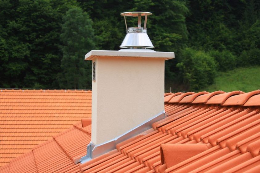 beautiful roof with a new chimney