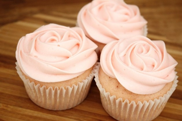 Miniature cupcakes with rose and pink colored icing