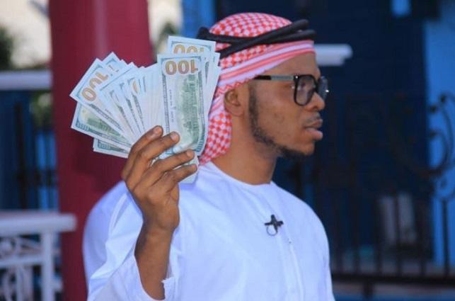 Obinim flaunts US$100 notes to celebrate 'freedom'
