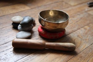 tibetan singing bowl with mallet and pebbles