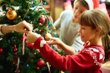 picture of children decorating a Christmas tree (or xmas tree)