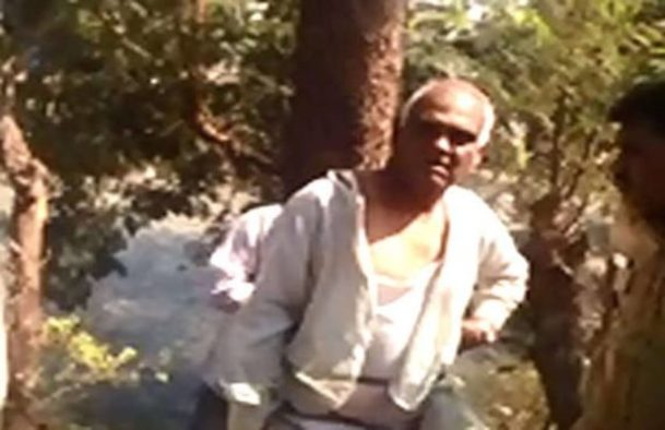 angry people in vadodara tied bjp councilor with tree