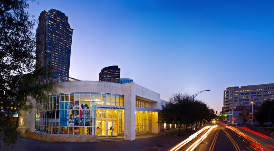 Image: The Levine Museum of the New South at sunset; car lights streaking