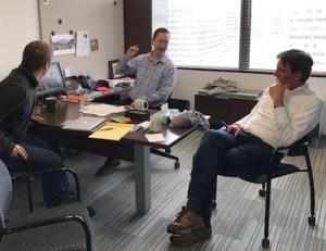 Rob Stein, Josh Morin and Harry Verwayen talking impact in AAM's offices.