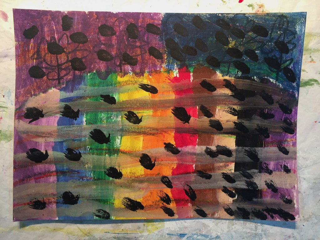 Rainbow colored painting with black polka dots throughout.