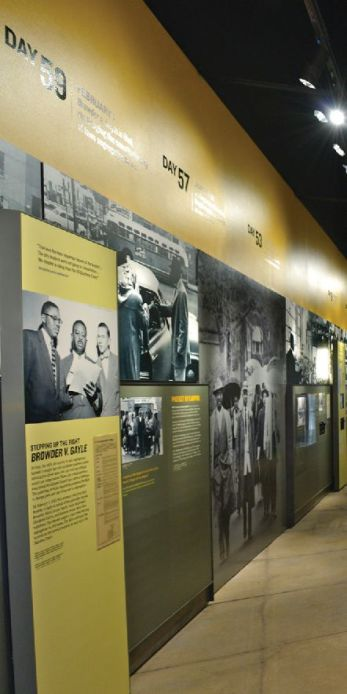 Exhibit image of images and text on a yellow wall .