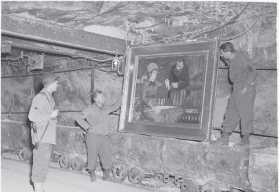 View of several soldiers viewing the Edouard Manet's Wintergarden in the Merkers salt mine, April 1945.