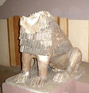 View of a terra-cotta lion without its head.