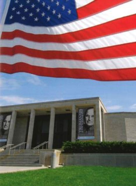 Image of the exterior of the museum with the American flag flying at the top of the image.