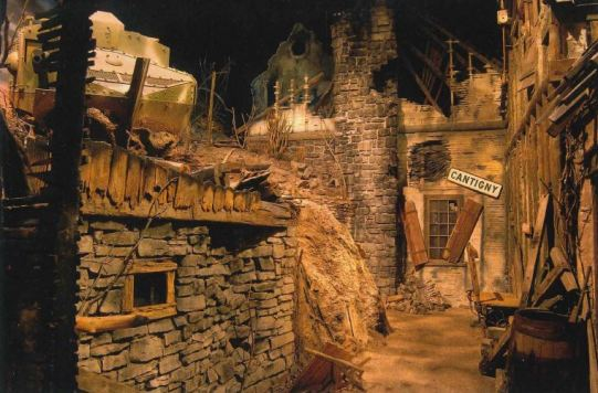 A simulated bombed-out World War I French village with ravaged stone buildings.