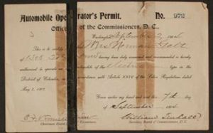 A scanned image of Edith Bolling Wilson's driver's license before conservation with two pieces of paper sitting side by side.
