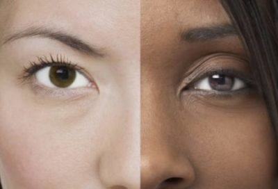 The halves of two faces are combined to form one composite face, half lighter-skinned and half darker-skinned, imagery the Science Museum of Minnesota uses to provoke thought about the concept of race and what science if any underlies it