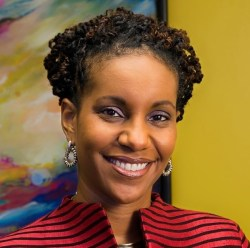 Headshot of Dr. Tonya Matthews, a black woman with short curly black hair wearing a striped black and red jacket.