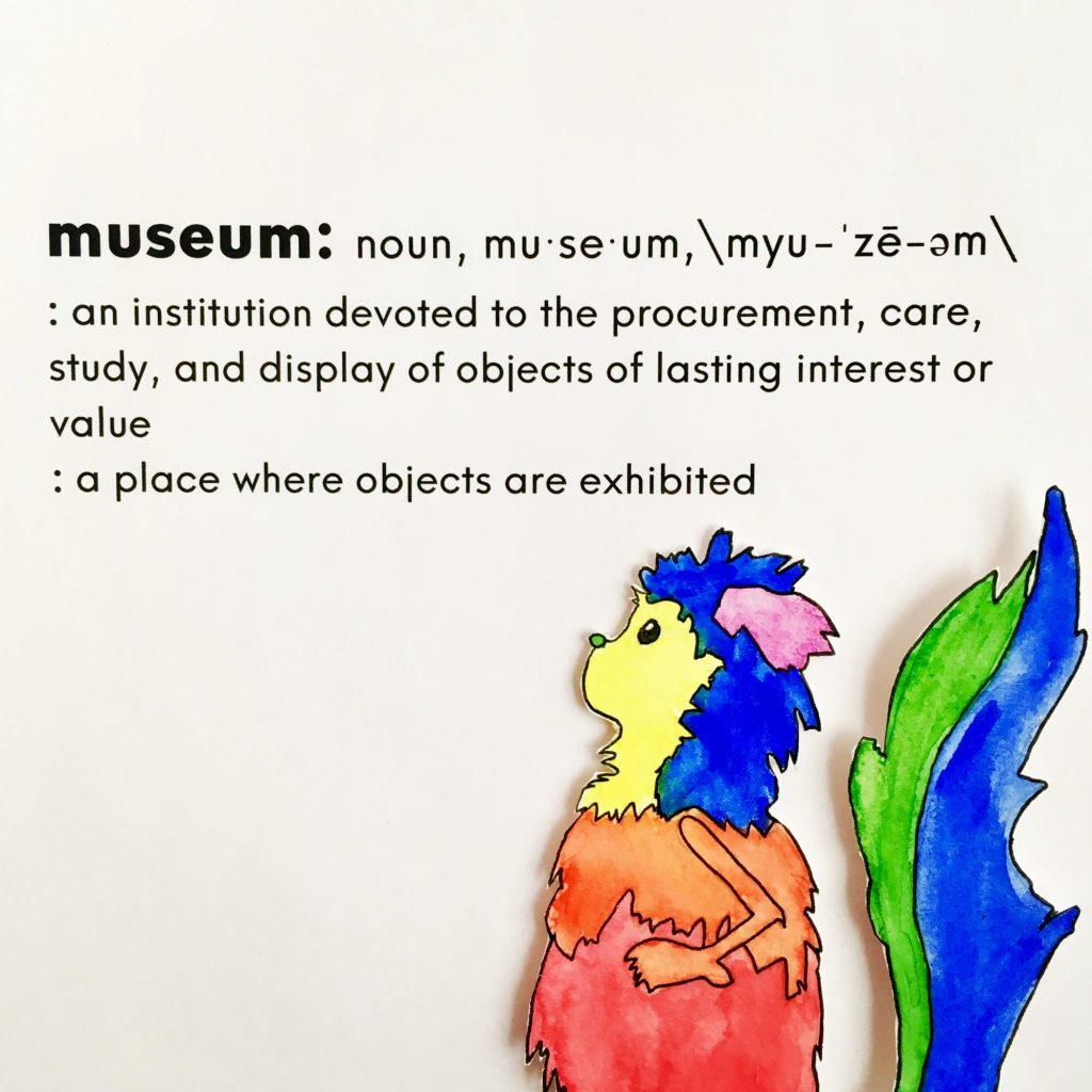 """Marabout is shown in front of a dictionary definition for the word museum. They are seen in profile and have a multicolored coat of purple, blue, yellow, red, and green. The definition reads: """"Museum: an institution devoted to the procurement, care, study, and display of objects of lasting interest or value; a place where objects are exhibited."""""""