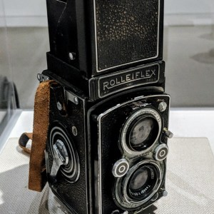 An antique camera on display in a museum.