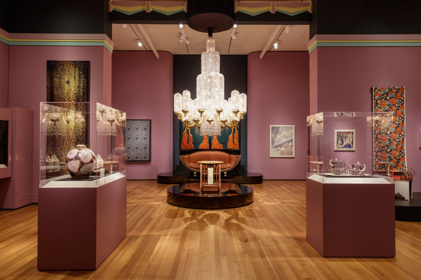 A gallery from the exhibition The Jazz Age: American Style in the 1920s, with decorative arts like a chandelier, furniture, and ceramics on display.