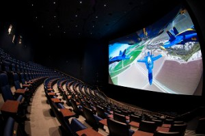 A theater with a screen showing a film of animated planes