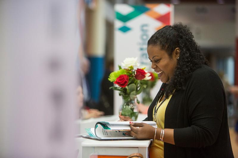 A Black woman reads a magazine
