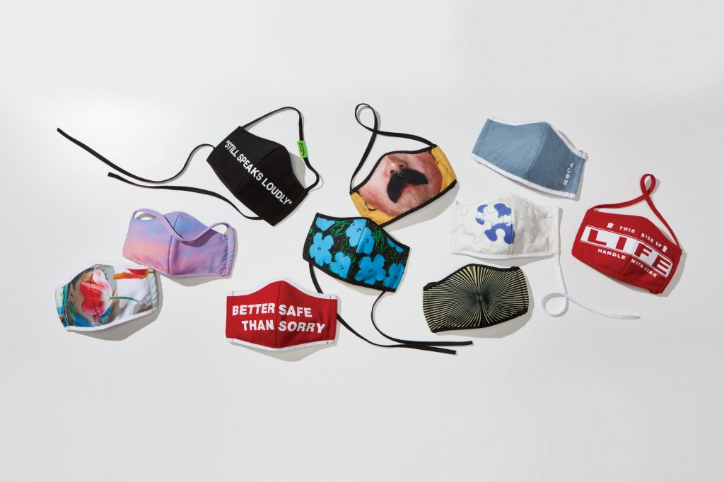 "An array of face masks in varying prints, including the messages ""Life: Handle with Caution"" and ""Better Safe Than Sorry."""