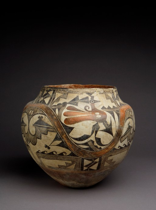 A pot decorated with geometric designs and a bird motif