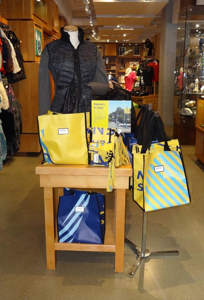 A table displaying colorful reusable bags
