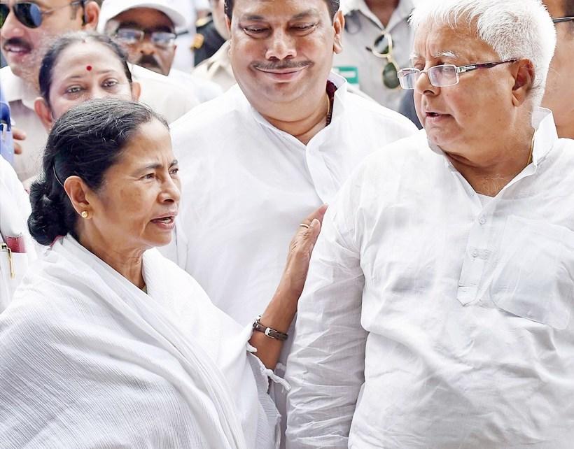 Kolkata: West Bengal Chief Minister Mamata Banerjee with RJD Chief Lalu Prasad Yadav after taking oath  in Kolkata on Friday. PTI Photo by Ashok Bhaumik(PTI5_27_2016_000186A)
