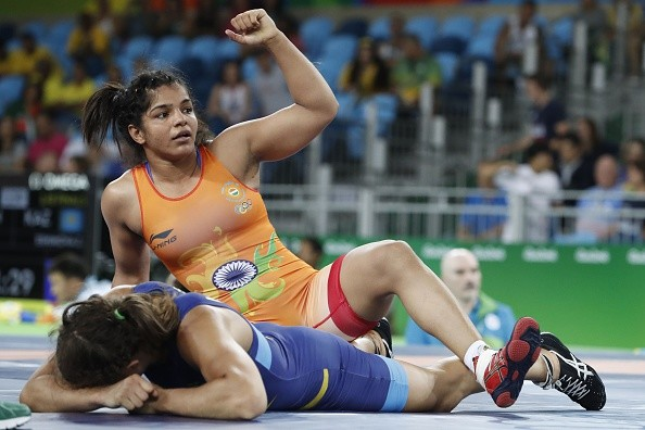 India's Sakshi Malik (top) celebrates during her fight againt Sweden's Malin Johanna Mattsson in their women's 58kg freestyle qualification match on August 17, 2016, during the wrestling event of the Rio 2016 Olympic Games at the Carioca Arena 2 in Rio de Janeiro.