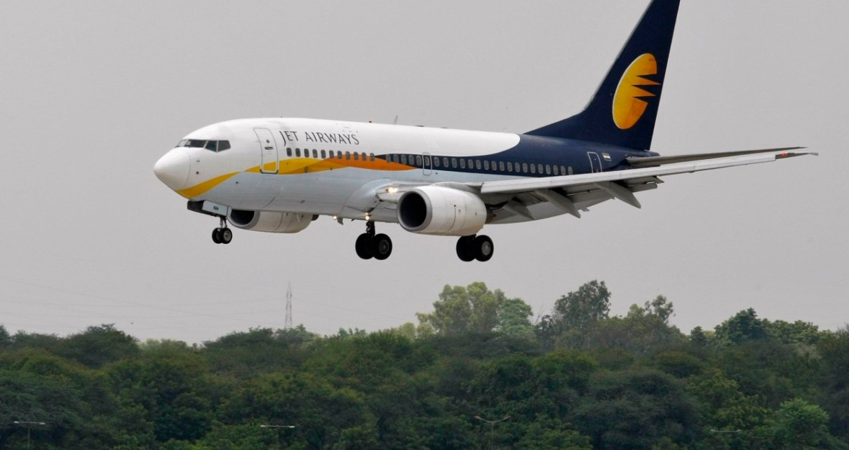 A Jet Airways passenger aircraft prepares to land at the airport in the western Indian city of Ahmedabad August 12, 2013. Jet recently won a key regulatory approval for its deal to sell a 24 percent stake to Etihad for $379 million, which will be the biggest foreign investment in the Indian civil aviation sector after ownership rules were relaxed. The companies, which need some more approvals, are yet to close the deal. REUTERS/Amit Dave (INDIA - Tags: TRANSPORT BUSINESS)