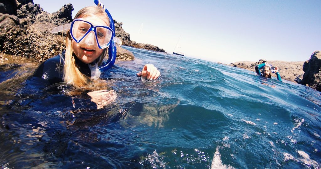 Gutsy girls snorkeling the sea caves of the channel islands