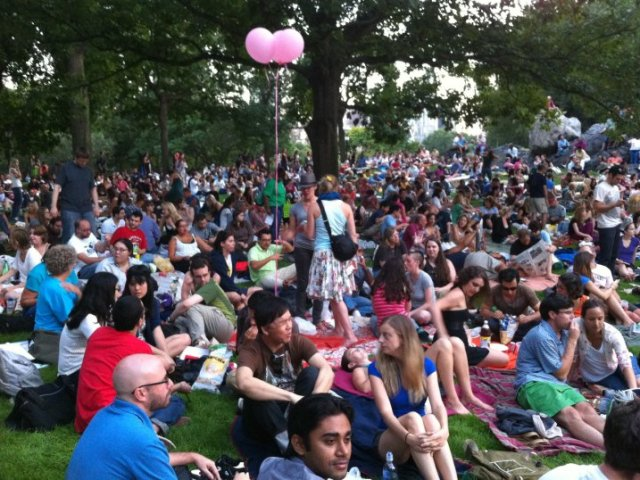 CouchSurfers watching a movie in Central Park
